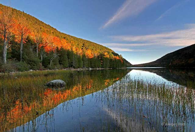 Photo guide to Acadia National Park: Maine fall foliage reflected in Bubble Pond by Juergen Roth.