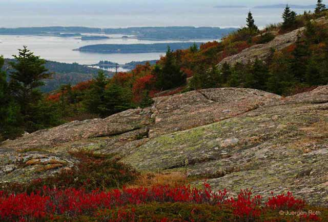 Photo guide to Acadia National Park: Maine fall foliage and rock formations overlooking Frenchman Bay by Juergen Roth.