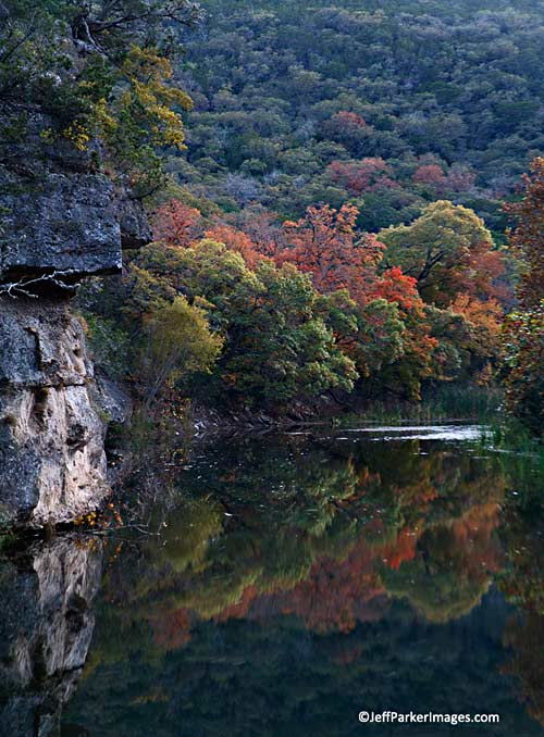 Fall photos: colorful autumn trees reflected in a lake by Jeff Parker.