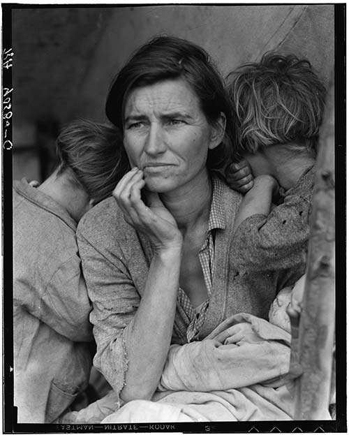 """Migrant Mother: The Library of Congress caption reads: """"Destitute pea pickers in California. Mother of seven children. Age thirty-two. Nipomo, California."""" Pictured: Florence Owens Thompson with three of her children. Photo Credit: Dorothea Lange, 1936"""