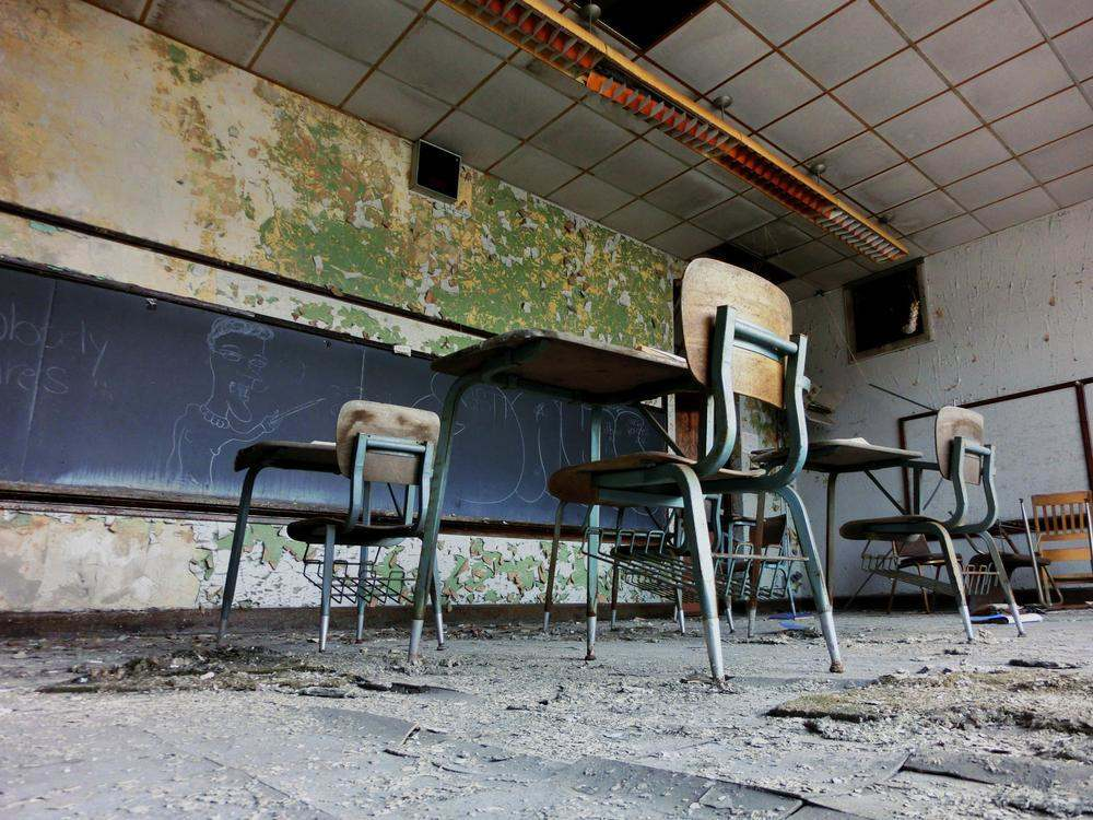 Abandoned school classroom with desks in Gary, Indiana - landscape photo